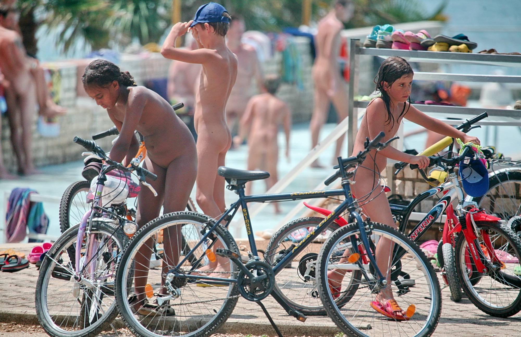Purenudism Gallery Naturist Pool Bike Rack - 1