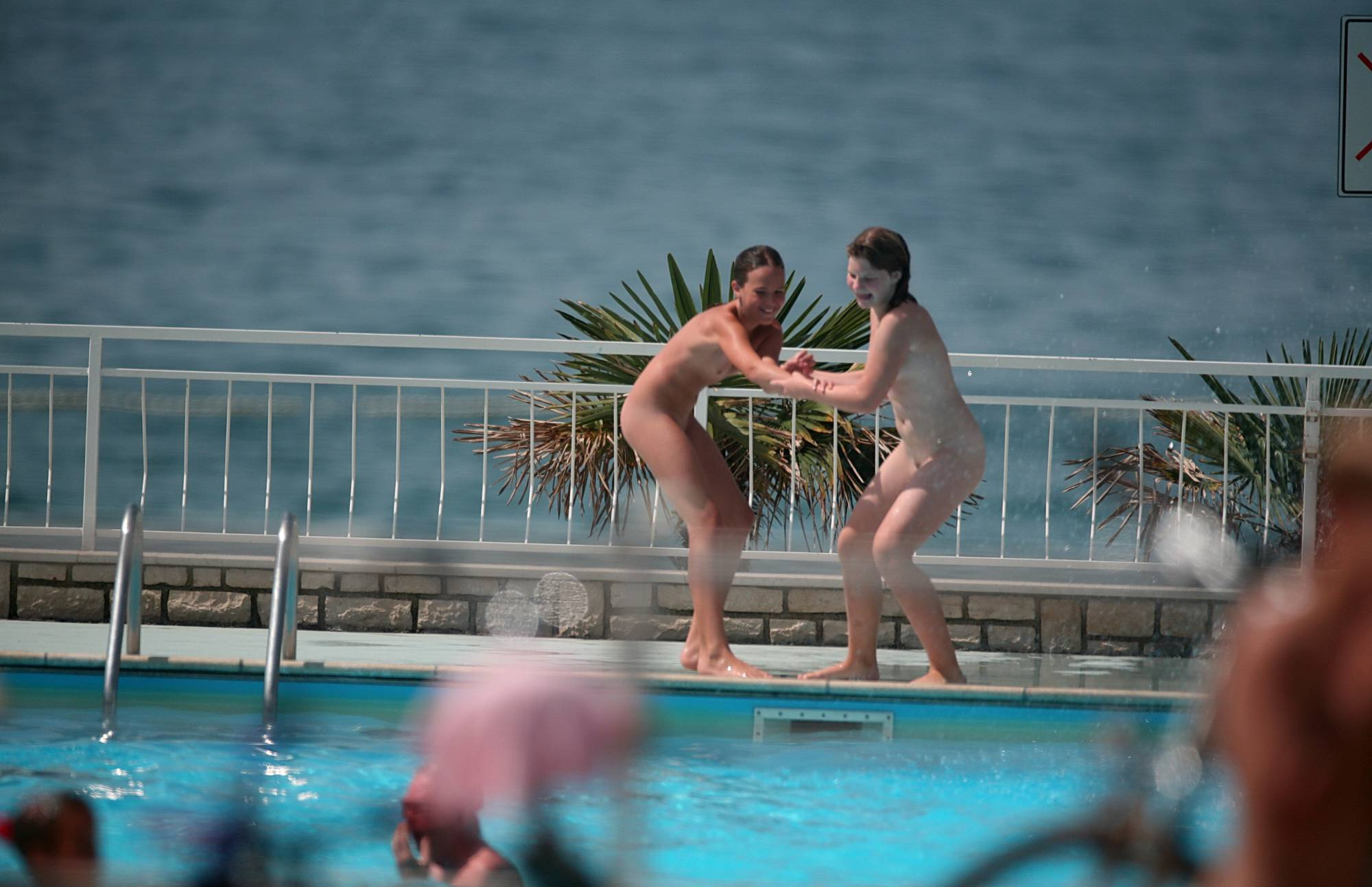 Nudist Pictures Push a Girl Into the Pool - 2