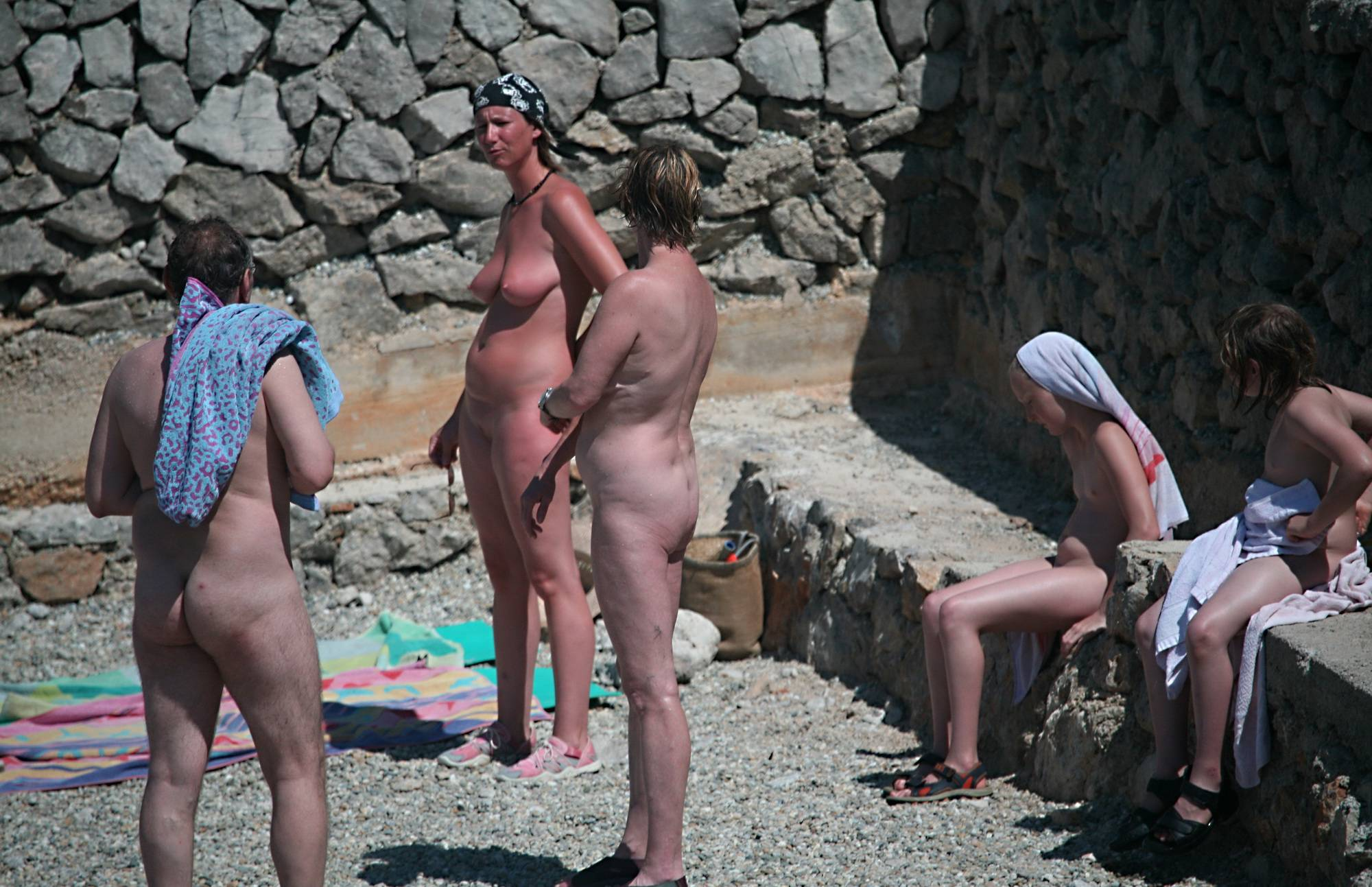Nudist Pics Family Talking By The Wall - 2