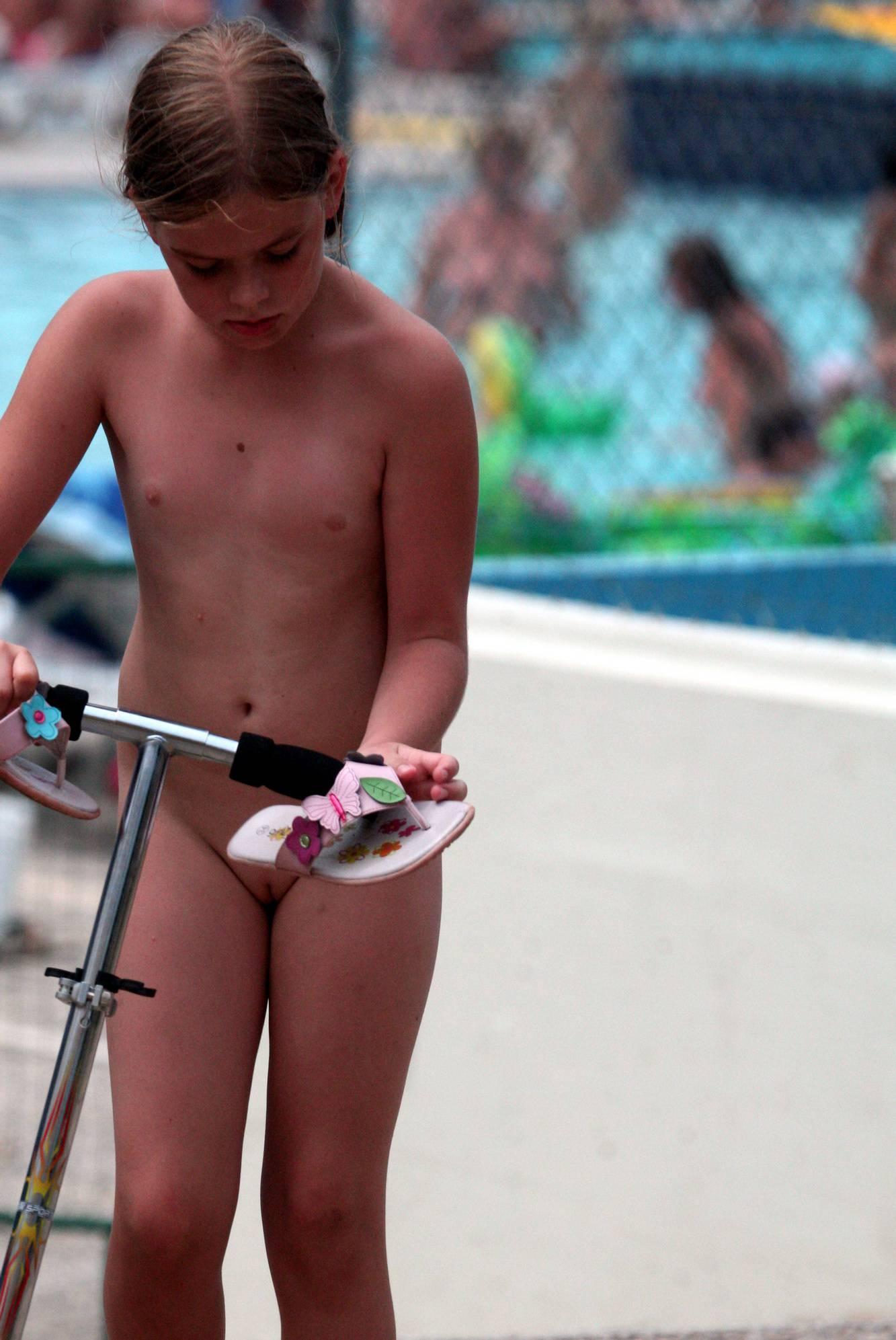 Nudist Pics Pool-Side Naturist Scooter - 1