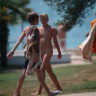Two Nudist Friends Walk